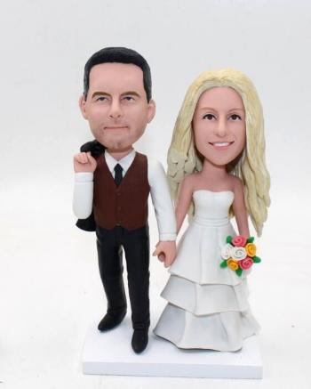 Casual bobblehead cake toppers