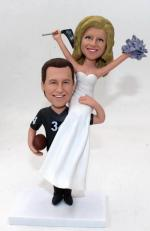 Sport themed wedding bobbleheads cake topper
