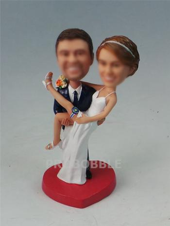 Groom carrying bride country wedding bobbleheads cake topper
