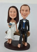 Custom wedding cake topper bobbleheads sitting on bench [AM1997]