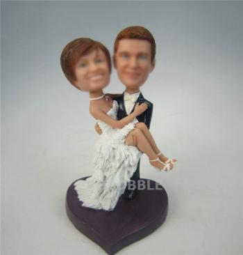 Groom carrying bride cake topper wedding bobbleheads