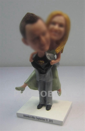 Groom carrying bride wedding bobbleheads