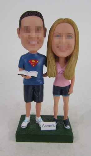 Custom casual couple bobbleheads cake topper superman groom